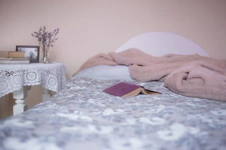 senior bed with book and a blanket