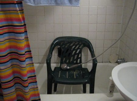 homemade shower chair in the tub